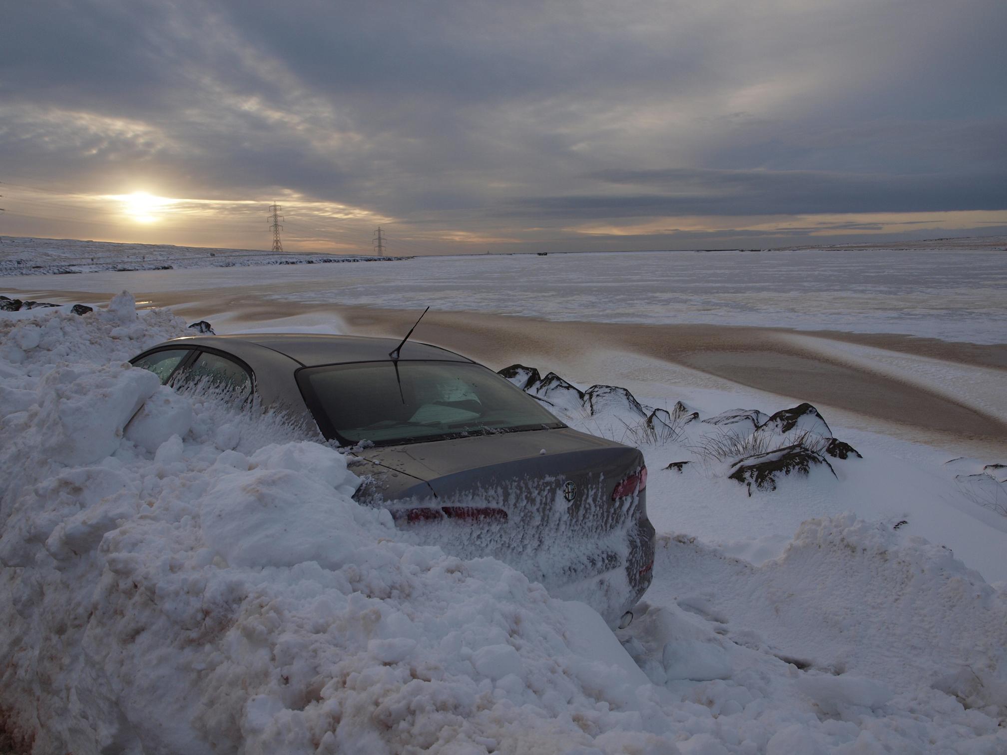 car in snow drift blackstone edge